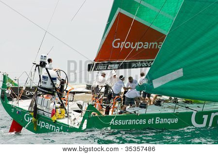Frank Cammas And Crew Aft Of The Mast Aboard Groupama Sailing Team