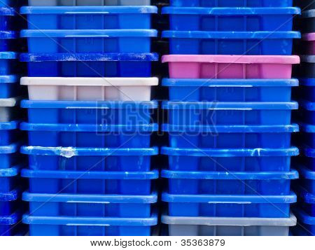 Stack of empty colorful plastic fishery containers