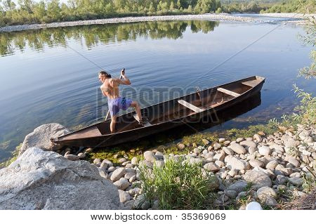 Oarsman On River