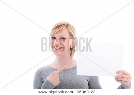 Smiling Woman Pointing To Blank Sign