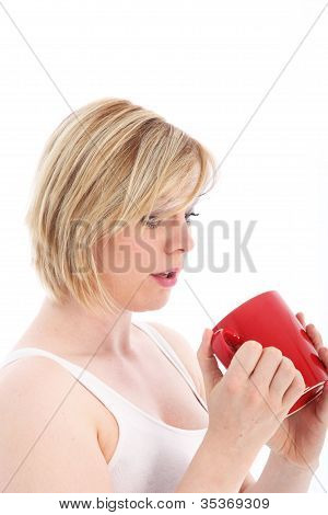 Woman Looking With Dismay At Empty Mug