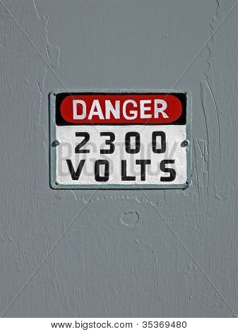 Danger 2300 Volt As Text On Vintage Wooden Wall, Electricity Details