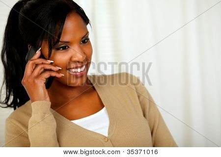 Beautiful Black Woman Conversing On Mobile Phone