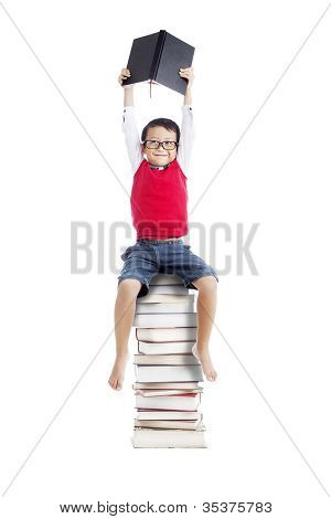 Asian Student Sitting On Stack Of Books