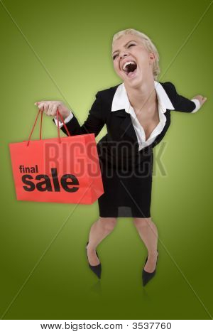Beautiful  Woman With A  Sale Shopping Bag On Isolated Green