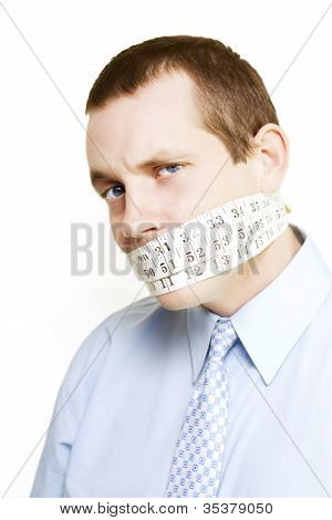 Silent businessman showing measured restraint