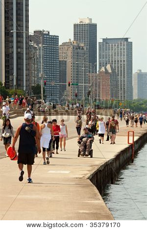 Locals And Tourists Being Active Along Chicago Shoreline On Lake Michigan