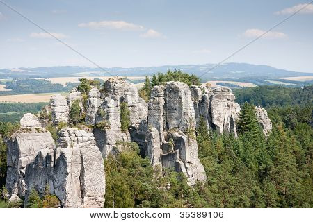 Sandstone Pillars Arising Above The Wood In The Czech Republic