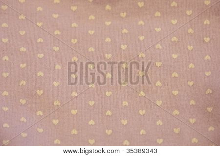 yellow hearts on a purple fabric background
