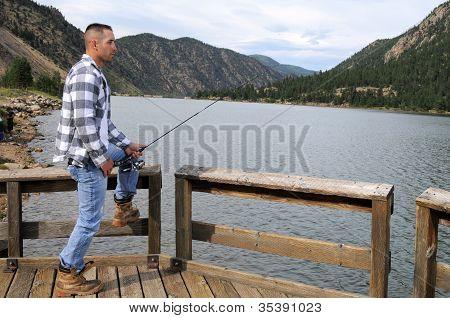 Man Fishing At The Lake