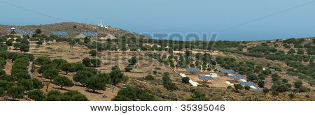 Solar Batteries In Crete Mountains Near Olive Trees