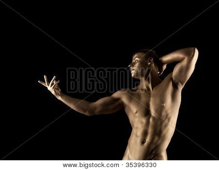 Strong athletic man portrait with metal skin