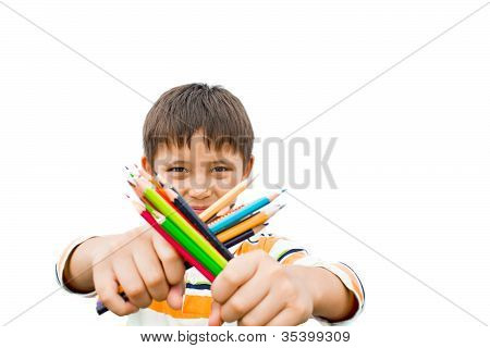 Boy With Colored Pencils In Their Hands