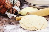 stock photo of flour sifter  - Dough and fresh butter eggs and flour for making biscuits or bread - JPG