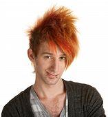 stock photo of mohawk  - Smiling teen punk with orange mohawk over white - JPG