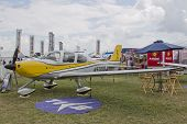 Yellow Cirrus R22 Plane