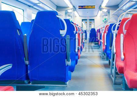 Passenger seats in an empty train.