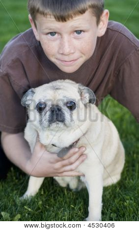 Portrait Of Young Boy With Dog