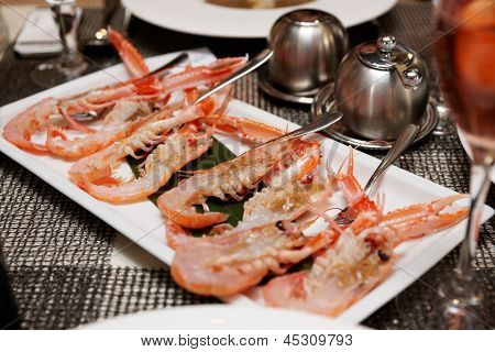Raw scampi dish on restaurant table - tasty seafood
