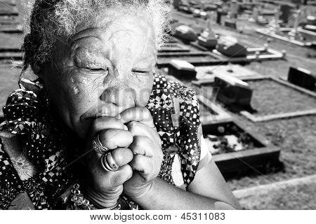 Elderly woman very sad