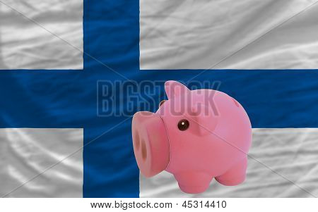 Piggy Rich Bank And  National Flag Of Finland
