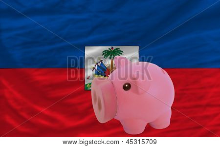 Piggy Rich Bank And  National Flag Of Haiti