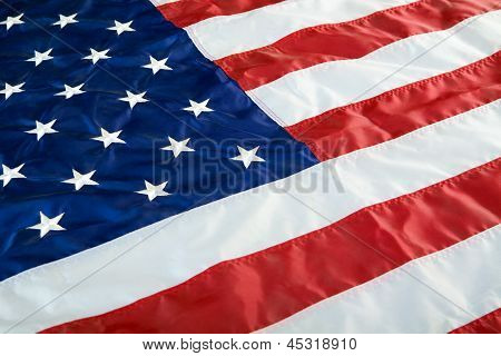 Crumpled, vintage American flag. Real photo.