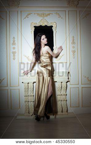 Girl In Golden Elegant Dress