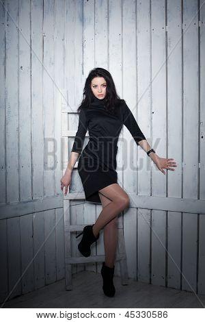 Girl In Black Dress Over White Background