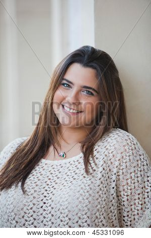 Portrait of a overweight woman smiling