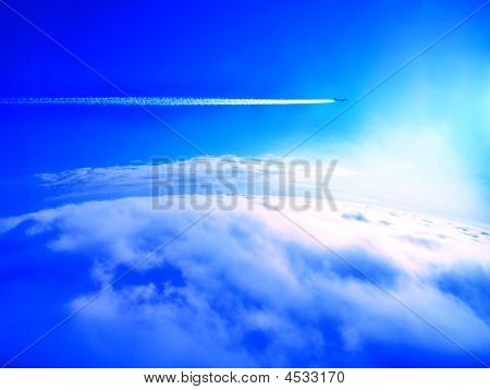 Airplane Trail Above The Clouds