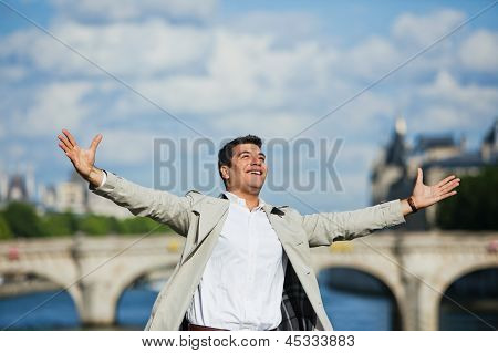 Man smiling with his arm outstretched