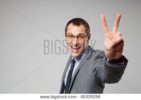 Happy business man holding thumbs up