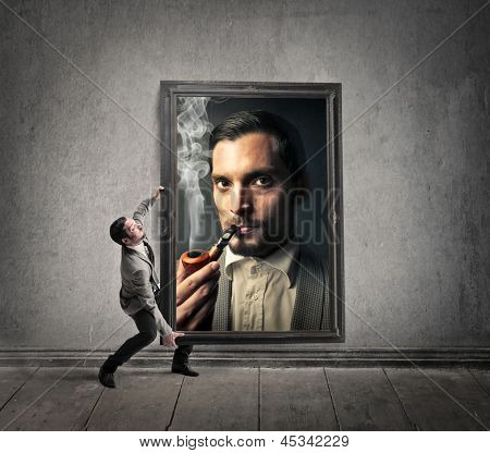 businessman carries large frame with self-portrait