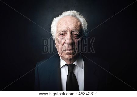 portrait of serious elderly businessman