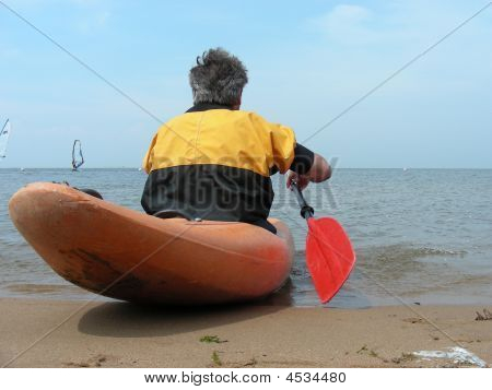 Man In Kayak With Red Oar