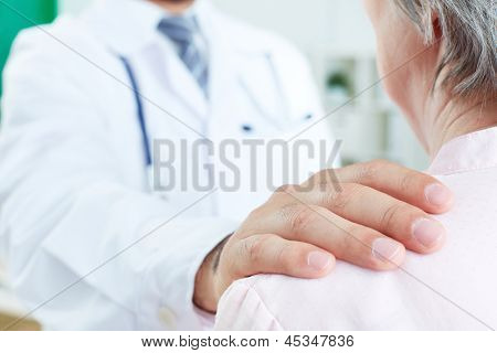 Image of doctor hand on patient shoulder