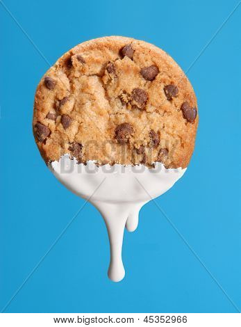 Soaking cookie on milk.
