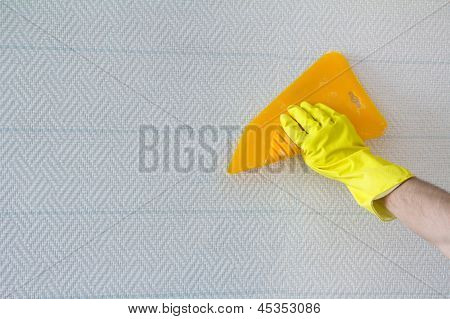 Hand With Spatula Smoothing Wallpaper