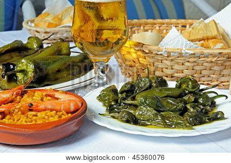 Selection of Spanish tapas with beer, Spain.