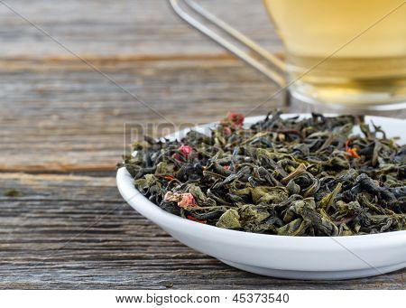 Green Tea Leaves And Cup Of Tea