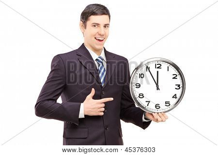 A young man in suit pointing on a clock, isolated on white background
