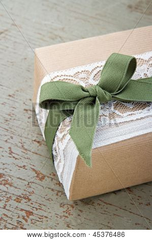 Simple Decorative Gift Box Wrapped In Brown Eco Paper And Lace
