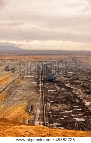 Industrial landscape of a working mine with black coal