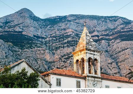 Medieval Bell Tower And Biokovo Mountains In The Background, Makarska, Croatia