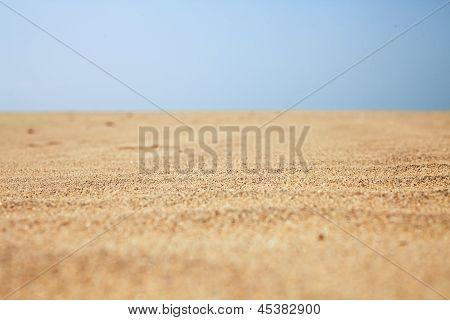 Dry Beach Sand And Clear Blue Sky