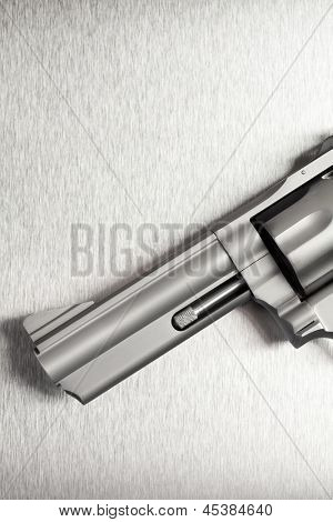 Gun on brushed metal background - a modern revolver.