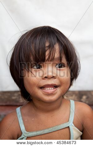 Portrait of an adorable Asian girl from impoverished area in the Philippines.