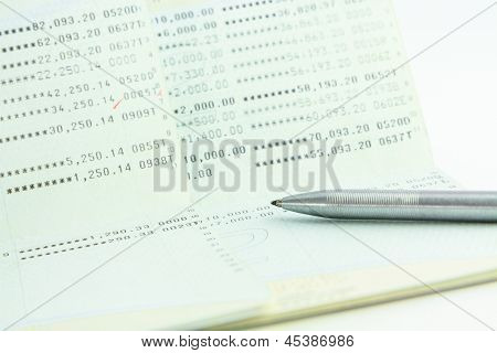 Account Passbook With A Pen