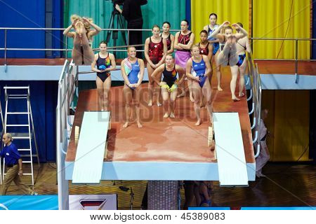 MOSCOW - APR 13:  Female athletes perform syncronized jump in Pool of SC Olympic on day of third phase of the World Series of FINA Diving, April 13, 2012, Moscow, Russia.